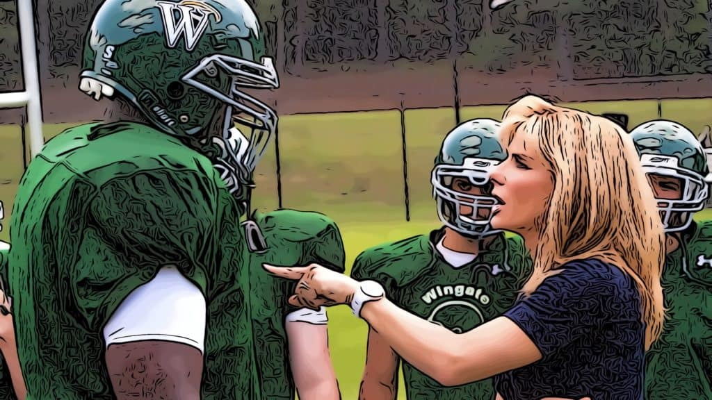 Scene from The Blind Side for movies about foster care post.